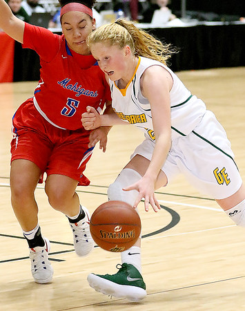 (Brad Davis/The Register-Herald) Greenbrier East's Kate Perkins drives to the basket as Morgantown's Aliyssa Neal defends during Big Atlantic Classic action Saturday the Beckley-Raleigh County Convention Center.