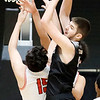 Westside's Corey Hatfield (44) grabs a offensive rebound over Oak Hill's Donte Billeter (15) during the first half of their basketball sectional championship Thursday in Beckley. (Chris Jackson/The Register-Herald)