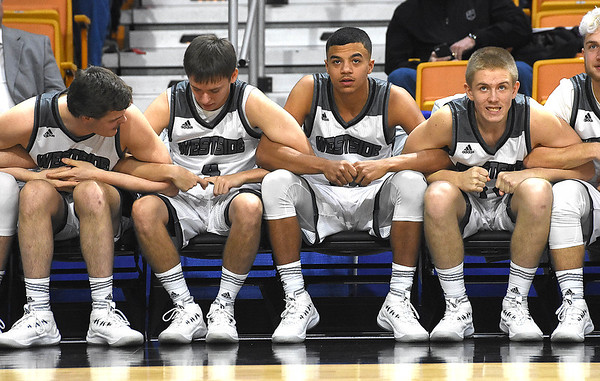 Westside bench lock arms with hopeo fo beating Winfield in the quarter-final game of the Class AA Boys State Basketball Tournament held at the Charleston Civic Center. Winfield won 68-65<br /> (Rick Barbero/The Register-Herald)