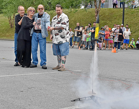 "(Brad Davis/The Register-Herald) An All-Star group consisting of (from left) West Virginia filmmaker Daniel Boyd, ""Mrs. Gilligan"" Dreama Denver, Rocket Boy Roy Lee Cooke and rocket enthusiast Tom Moseley launch a rocket together as spectators look on to kick off the rocket launching portion of events at the Rocket Boys Festival Saturday afternoon at the Exhibition Coal Mine."