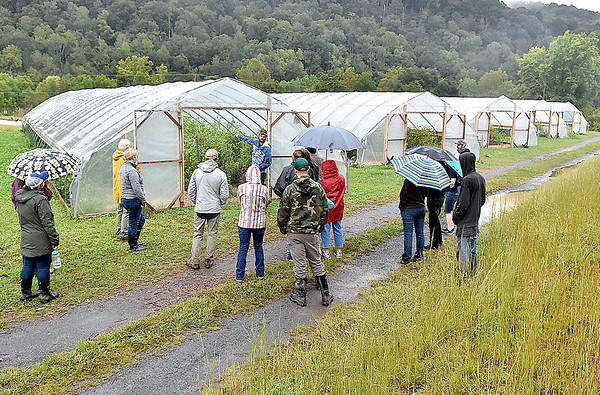 (Brad Davis/The Register-Herald) A group of visitors are shown an array of high tunnels, the primary method of farming being used and developed on the grounds of Sprouting Farms during a WV CRAFT (Collaborative Regional Alliance for Farmer Training) open house style event Sunday afternoon in Talcott.