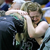 (Brad Davis/The Register-Herald) Wyoming East seniors Allie Lusk, right, and Gabby Lupardus try to console each other following the Lady Warriors' Class AA State Championship game loss to North Marion Saturday afternoon at the Charleston Civic Center.