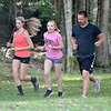 (Brad Davis/The Register-Herald) Shady Spring cross country head coach Eric Lawson, right, runs with team members Lexi Zilinski, left, and Sierra Kesner, middle, as they trek around Little Beaver Park during a practice Wednesday afternoon.
