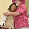 (Brad Davis/The Register-Herald) Theatre West Virginia actress Rhayne Thomas gets a big hug from general manager Scott Hill after speaking to audience members about her battle with breast cancer during a rain delay prior to the year's final performance of Hatfields & McCoys Sunday evening at Grandview's Cliffside Amphitheatre. Thomas has now been cancer free for 7 years, and fans wore pink along with staff in a show of support.
