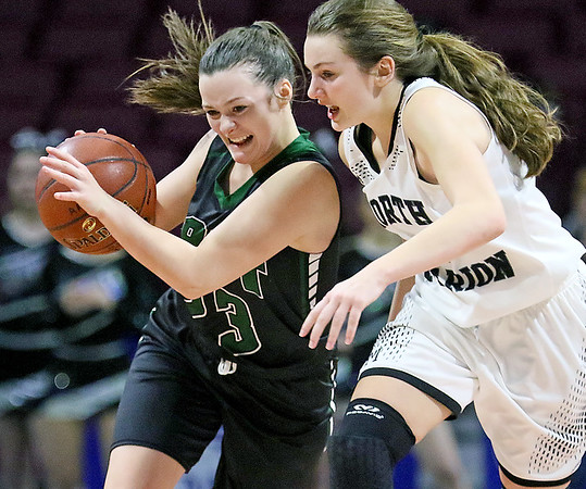 (Brad Davis/The Register-Herald) Wyoming East's Katie Daniels shields the ball as she wins a battle for it with North Marion's Taylor Buonamici at mid court Saturday afternoon at the Charleston Civic Center.