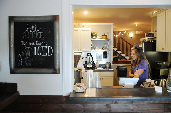 Appalachian Coffee House employee Felicity Fitzwater looks on at the store in Mt. Nebo. (Chris Jackson/The Register-Herald) <br /> <br /> employee felicity fitzwater