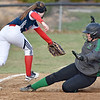 (Brad Davis/The Register-Herald) Fayetteville's Rachel Peelish slides into third base as an errant throw gets past Independence infielder Caroline Parrish Wednesday evening at Fayetteville Town Park.