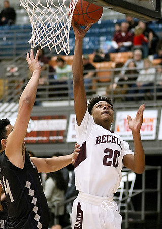 (Brad Davis/The Register-Herald) Woodrow Wilson's Mikey penn drives and scores as Riverside's T.J. Wood defends Wednesday night at the Beckley-Raleigh County Convention Center.
