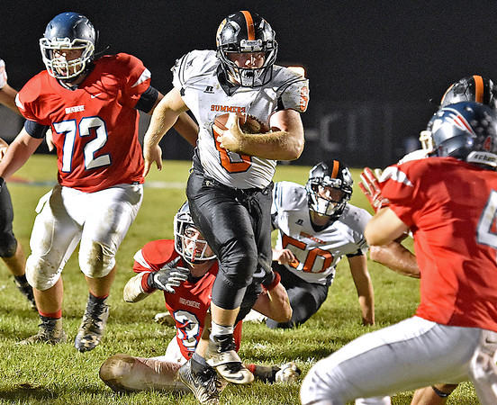 (Brad Davis/The Register-Herald) Summers County ball carrier Marcus McGuire gets past Independence defender Mason Kump (#3) on his way to a first quarter touchdown run Friday night in Coal City.