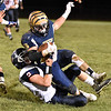(Brad Davis/The Register-Herald) Shady Spring's Tyler Bragg is taken down by Independence defender Cohen Miller after a big gain Thursday night in Shady Spring.
