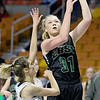 (Brad Davis/The Register-Herald) Wyoming East's Emily Saunders drives and scores as North Marion's Brielle Osborne defends Saturday afternoon at the Charleston Civic Center.