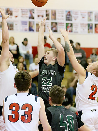 (Brad Davis/The Register-Herald) Wyoming East's McQuade Canada drives and scores through Independence defenders Marc Sauno, left, and Blake Stone Friday night in Coal City.