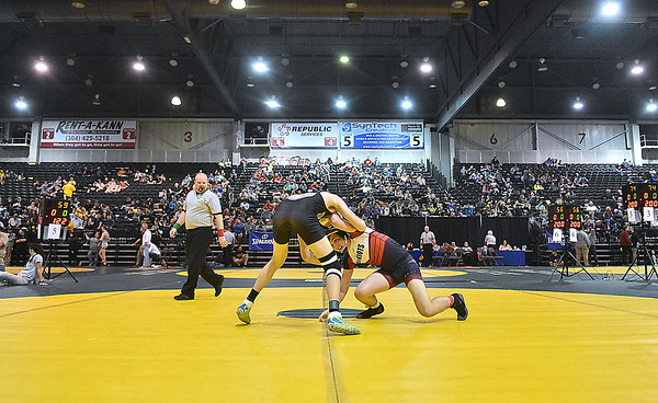 (Brad Davis/The Register-Herald) Scenes from the 2018 State Wrestling Tournament at Huntington's Big Sandy Arena.