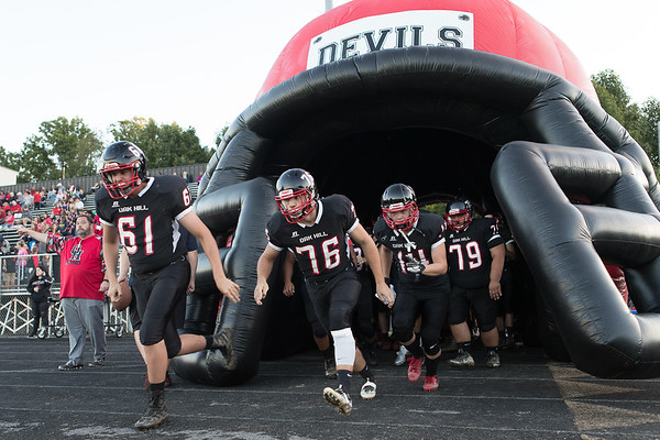 The Oak Hill Red Devils take the field. Chad Foreman for the Register-Herald.
