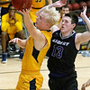 (Brad Davis/The Register-Herald) WVU Tech's Andreas Jonsson drives and scores as Asbury's Clif Conley watches during a comeback victory Wednesday night at the Beckley-Raleigh County Convention Center.