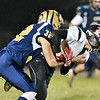 Shady Spring's Jadon Hershberger (32) tackles Liberty's Shawn Pennington (12) during their high school football game Friday in Shady Spring. (Chris Jackson/The Register-Herald)