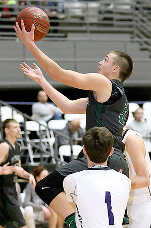 (Brad Davis/The Register-Herald) Wyoming East's Evan Preece drives and scores as James Monroe's Cory Boothe defends during Big Atlantic Classic action Wednesday night at the Beckley-Raleigh County Convention Center.