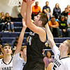 (Brad Davis/The Register-Herald) Westside's Corey Hatfield drives to the basket as Shady Spring's Steven Williams, right, and Tommy Williams (behind Hatfield) defend Wednesday night in Shady Spring.