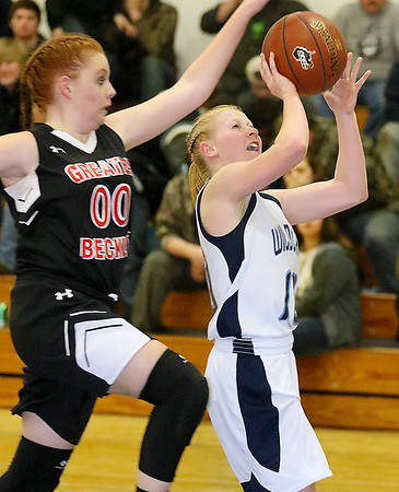 (Brad Davis/The Register-Herald) Meadow Bridge's Kaylie Persinger breaks away and lays the ball up for two before Greater Beckley Christian's Grace Mitchell can stop her Thursday night in Meadow Bridge.