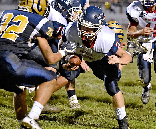 (Brad Davis/The Register-Herald) Independence's Cohen Miller falls forward as Shady Spring's Jadon Hershberger is in position for the hit Thursday night in Shady Spring.