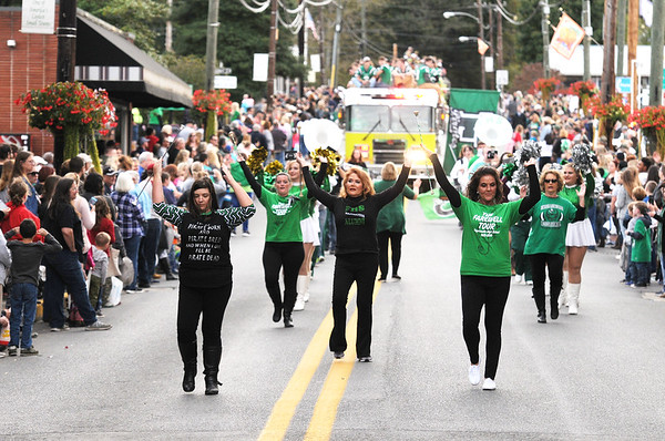 Current and former members of the Fayetteville High School marching band perform during their homecoming parade in Fayetteville on Friday. (Chris Jackson/The Register-Herald)