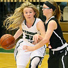 (Brad Davis/The Register-Herald) Wyoming East's Gabby Lupardus scans ahead for an open teammate as she holds off PikeView defender Cheyanne Graham Thursday night in New Richmond.