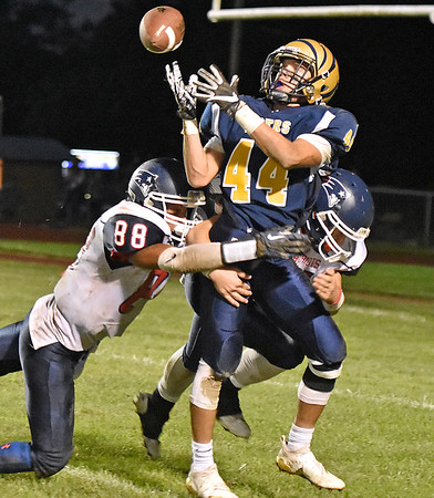 (Brad Davis/The Register-Herald) Shady Spring receiver Isaiah Valentine nearly has a deep ball caught but loses it as he's popped by Independence defenders Niko Burgess, left, and Isaiah Duncan Thursday night in Shady Spring.