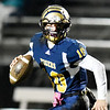 Shady Spring quarterback Drew Clark (10) rolls out of the pocket during their high school football game Friday in Shady Spring. (Chris Jackson/The Register-Herald)