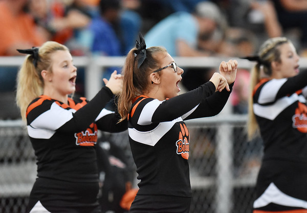 Summers County cheerleaders perform <br /> during their high school football game Thursday in Hinton. (Chris Jackson/The Register-Herald)