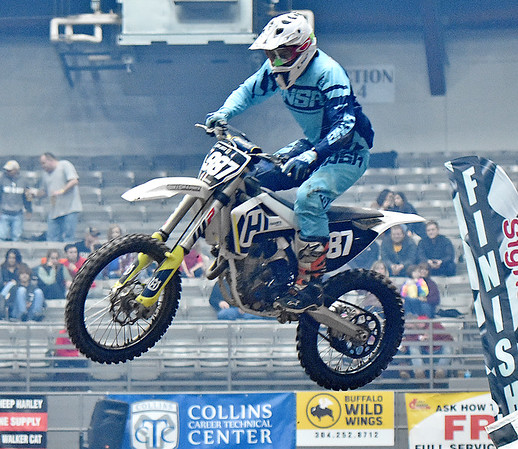 (Brad Davis/The Register-Herald) Louisa, Kentucky resident Eddie Greer treads air during the weekend's Tristate MX dirt bike racing event Saturday night at the Beckley-Raleigh County Convention Center.