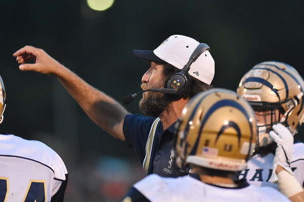 Shady Spring coach Vince Culicerto with his team during a timeout during their high school football game against Summers County Friday in Hinton. (Chris Jackson/The Register-Herald)