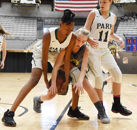 Park's ZaMahya Moss (32) and Shady Spring's Braylie Wiseman (10) battle for a lose ball as Olivia Ziolkowski (11) looks on during the third quarter of their Big Atlantic Tournament Consolation basketball game Tuesday in Beckley. (Chris Jackson/The Register-Herald)