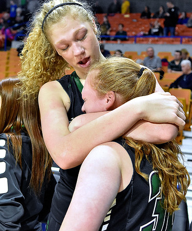 (Brad Davis/The Register-Herald) Wyoming East's Emily Saunders consoles younger sister and teammate Sarah Saunders following the Lady Warriors' loss in the Class AA Girls State Basketball Tournament Saturday afternoon at the Charleston Civic Center.