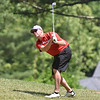 (Brad Davis/The Register-Herald) Trent Roush leans over to watch his shot from an embankment on 16 during third round action at the West Virginia Amateur Wednesday afternoon on the Greenbrier's Meadows Course.