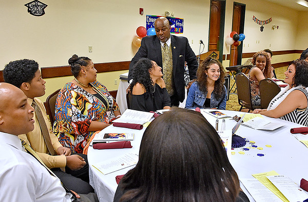 (Brad Davis/The Register-Herald) Quincy A. Madison, President of the BEAUTY (Black Educators Are United Totally - Yes!) program, chats with graduates and their families Saturday night.
