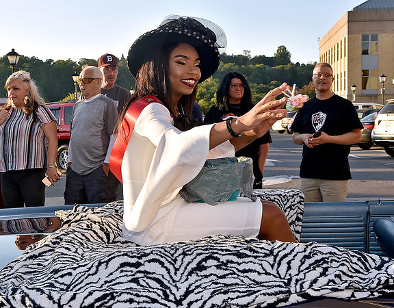(Brad Davis/The Register-Herald) Miss Flying Eagle Court participant Nataijah McCormick tosses candy to the masses during the Woodrow Wilson homecoming parade Wednesday evening in downtown Beckley.