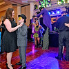 (Brad Davis/The Register-Herald) Attendees of all ages - and heights - gather for some dancing during the Mardi Gras-themed Fur Ball Saturday night at Tamarack.
