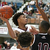 (Brad Davis/The Register-Herald) Woodrow Wilson's Mikey Penn drives as Bluefield's Devon Goins defends during the Little General Battle for the Armory Tournament Thursday night at the Beckley-Raleigh County Convention Center.
