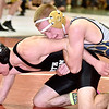 (Brad Davis/The Register-Herald) Nicholas County's Kyle Barker takes on North Marion's Cameron Wilson as the two square off in a 126-pound weight class matchup Friday night at the Summersville Arena and Convention Center. North Marion's Wilson would win the match.