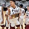 (Brad Davis/The Register-Herald) Woodrow Wilson's Eddie Christian, middle, and teammates collect the hardware following the Flying Eagles' Sectional Championship win over the Princeton Tigers Friday night at the Beckley-Raleigh County Convention Center.