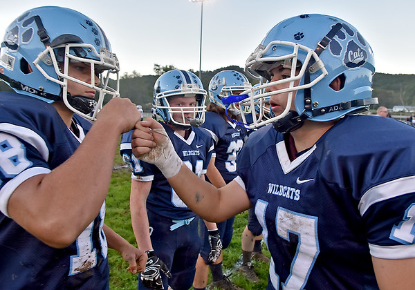 (Brad Davis/The Register-Herald) Meadow Bridge player Dillion Stephens, right, encourages his teammates during warmups for their home game against Valley Friday night in Meadow Bridge.