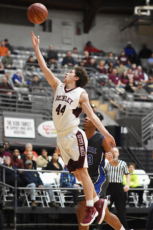 Woodrow's Danny Bickey (44) finishes an easy layup to the Capital basket during the second quarter of their basketball sectional championship against Tuesday in Beckley. (Chris Jackson/The Register-Herald)