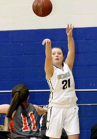 (Brad Davis/The Register-Herald) Nicholas County's Emily Parker shoots from three-point range against Summers County Wednesday night in Summersville.