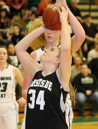 (Brad Davis/The Register-Herald) Westside's Halie Carter drives to the basket as Wyoming East's Emily Saunders defends Thursday night in New Richmond.