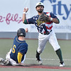 (Brad Davis/The Register-Herald) Miners 2nd baseman DePaul Blunt forces out Aviators baserunner Jason Cryar as he tries to turn a double play Saturday night at Linda K. Epling Stadium.