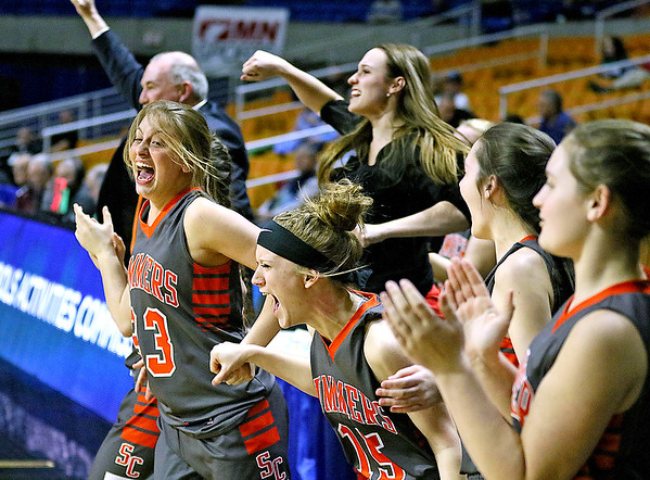(Brad Davis/The Register-Herald) The Summers County bench erupts as they hold on to defeat Parkersburg Catholic and advance to the next round of the Class A State Basketball Tournament Thursday night at the Charleston Civic Center.
