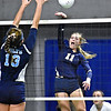 (Brad Davis/The Register-Herald) Shady Spring's Brooklyn Cook spikes the ball as Philip Barbour's McKenzie Carpenter defends during State Volleyball Tournament action Friday evening at the Charleston Civic Center.