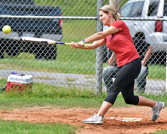 (Brad Davis/The Register-Herald) Director of Case Management Ashley Bradbury drills a pitch during the RGH Employee Softball game Sunday afternoon at Beckley Little league.