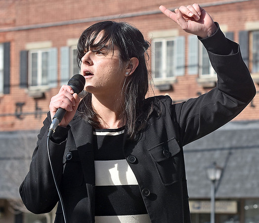 """(Brad Davis/The Register-Herald) Alexandra Gallo, Development Director at the West Virginia Citizens Action Group, delivers a speech to the large crowd on hand during the """"It's Our Time"""" rally marking the one-year anniversary of the Women's March Saturday morning in Beckley's Showmaker Square."""