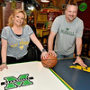 (Brad Davis/The Register-Herald) Calacino's owners Jamie and Jeff Weeks say they proudly support both schools when it comes to Marshall and WVU sports. The Robert C. Byrd Drive Pizzeria will be decked out in Kelly Green and Old Gold and Blue when the Mountaineers take on the Thundering Herd in tonight's NCAA Tournament game.